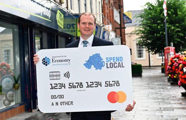 Economy Minister in North Gordon Lyons relaunching the high street voucher scheme last month with an emphasis on spending the money locally