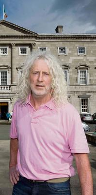 21/05/2013. MIck Wallace. Independent TD Mick Wallace speaks to the media on the plinth of Leinster House regarding Alan Shatter's disclosure of Mick Wallaces' personal information of driving while using a mobile phone on passed on by the Gardai. Photo: Laura Hutton/Photocall Ireland