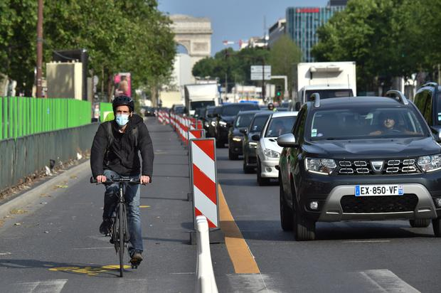 A cyclist rides in a new cycle lane in the Boulevard Charles de Gaulle in Paris