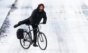 Cool rider: A man cycles in snow in Lucan, Co Dublin, yesterday. Photo: Niall Carson/ PA