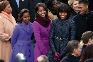 Barack Obama Sworn In As U.S. President For A Second Term...WASHINGTON, DC - JANUARY 21:  First lady Michelle Obama and daughters, Sasha Obama and Malia Obama arrive during the presidential inauguration on the West Front of the U.S. Capitol January 21, 2013 in Washington, DC.   Barack Obama was re-elected for a second term as President of the United States.  (Photo by Mark Wilson/Getty Images)...A