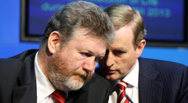 Taoiseach Enda Kenny , TD and Health Minister Dr. James Reilly , TD at the media briefing at Government Buildings following the publication of The Protection of Life during Pregnancy Bill 2013
