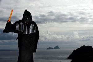 Darth invader: A Star Wars fan poses in front of the Skelligs Rocks near Portmagee in Co Kerry. Picture by Don MacMonagle