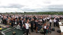 A crowd listens to former Sinn Fein president Gerry Adams speak during the funeral of senior Irish Republican and former leading IRA figure Bobby Storey at Milltown Cemetery in west Belfast. PA Photo.