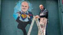 Superman: Artist Niall O'Loughlin painting a mural to chief medical officer Tony Holohan at Devitt's Pub on Camden Street, Dublin. Photo: Gareth Chaney/Collins