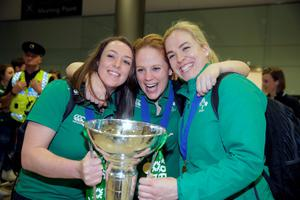 Gillian Burke, Fiona Hayes and Niamh Briggs, captain, with the trophy at Dublin Airport last night: Photo: Arthur Carron