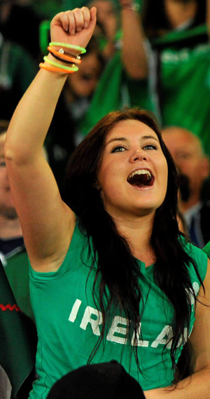 A fan celebrates during the Italy game at the last World Cup