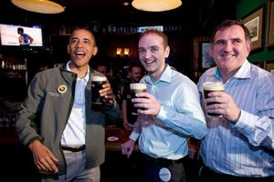 US President Barack Obama visits the Dubliner, an Irish pub in Washington DC, with Irish cousin Henry Healy (centre) and Ollie Hayes, a pub owner in Moneygall Picture: Pete Souza