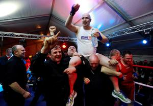 Fr Pierre Pepper is carried aloft after defeating Jared Madden during his amateur boxing match. Photo: PA