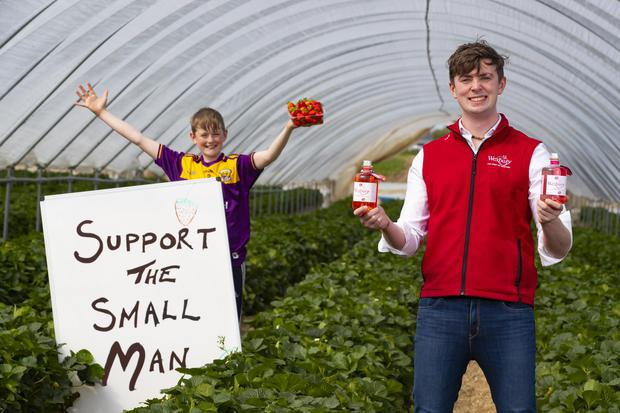 Pictured is Mark Kavanagh of Wexbury from Davidstown, Co. Wexford with his strawberry Vodka. also pictured is his younger brother Ben (13yrs). Picture: Patrick Browne