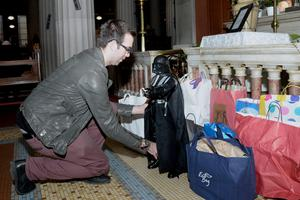 Brendan Gildea, from Swords, Co Dublin, donates his Darth Vader figure at St Mary's Pro Cathedral in Dublin, after an appeal for unwanted Christmas gifts. Photo: Justin Farrelly