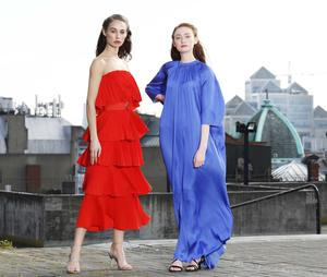 Stunning skyline: Models Thalia wears a red tiered dress by Essentiel Antwerp, (€285) and Emily wears a blue maxi dress by DAY Birger et Mikkelsen, (€245) from Arnotts SS20 collection. Photo: Leon Farrell/Photocall Ireland