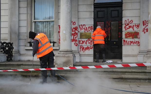 The graffiti being cleaned at the Department of Foreign Affairs building in Dublin. Photo: Gareth Chaney