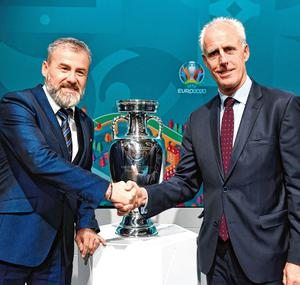 Republic of Ireland manager Mick McCarthy, right, and Slovakia manager Pavel Hapal following the UEFA Euro 2020 playoff draw at UEFA Headquarters in Nyon, Switzerland last November. Photo by UEFA via Sportsfile