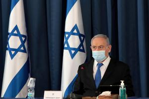 Second wave: Israeli Prime Minister Benjamin Netanyahu during a Cabinet meeting this week; and below, new restrictions have limited the number of worshippers at Israeli synagogues to 19