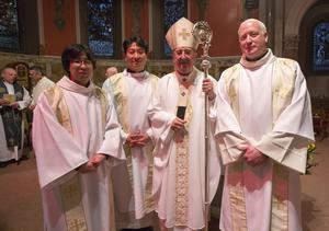 From left: Hjun-June Lee, Jae-wook Lee, Dr Diarmuid Martin, Archbishop of Dublin, and Shane Daly at the ordination ceremony in Milltown Park yesterday. Photo: Fergal Phillips.
