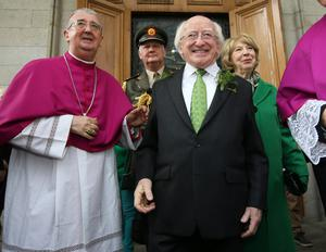 President Michael D Higgins with his wife Sabina and Archbishop of Dublin Diarmuid Martin after mass to celebrate the feast of St Patrick in the Pro Cathedral yesterday. Photo: Frank McGrath