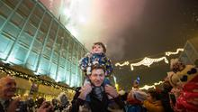 Neil Shanahan, the two-year-old boy who survived a six-storey fall from a hotel in the city in July turned on the Christmas lights