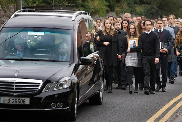 Mourners follow the coffin of Michael McCoy into St. Maelruain's Church of Ireland in Tallaght. Photo: Tony Gavin