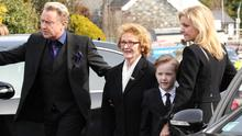 Michael Flatley with his mother, Eilish, son Michael Junior and wife Niamh at the funeral of his father, Michael James.