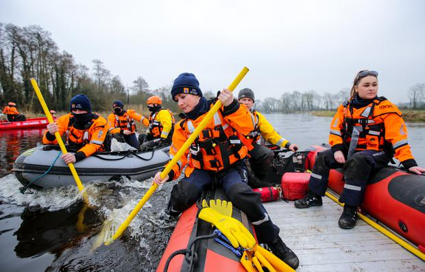 Pamela Hyland leads members of the Kildare Civil Defence boat unit search for the body of Declan Reid in the River Barrow at Ardreigh Lock near Athy Co. Kildare. Photograph by Gerry Mooney