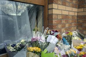Flowers left outside the family home of George Nkencho in Hartstown. Photo: Tony Gavin