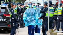 Six-week lockdown: Medical staff wearing PPE get ready to enter the Flemington flats in Melbourne, Australia after the city introduced new restrictions