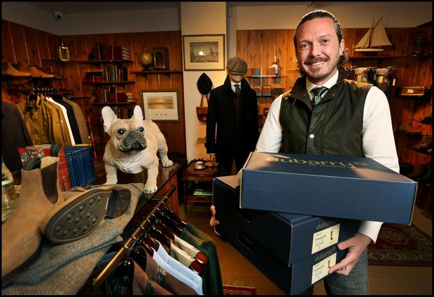 Keith Kenny, group retail manager of Dubarry of Ireland prepares to reopen its College Green premises. Photo: Steve Humphreys