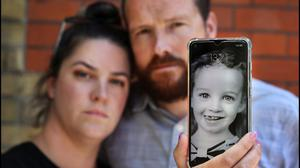 Estlin Wall's parents Amy and Vincent hold a photograph of their daughter outside the Coroners Court in Dublin during the inquest into her tragic death. Photo: Steve Humphreys
