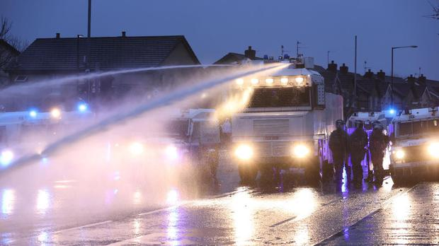 Water cannons were used on crowds gathering on the Springfield Road in Belfast. Photo: PA Media.