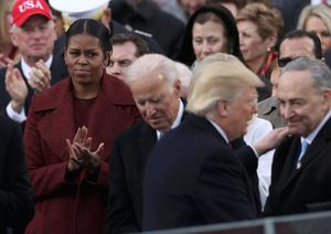 Outgoing US first lady Michelle Obama watches on at the Trump inauguration. Photo: Reuters