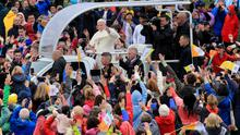 Worship:  Pope Francis greets the crowds during his recent visit to Ireland. Picture: Gerry Mooney