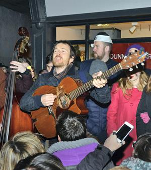 Damien Rice performs to a crowded audience of last-minute Christmas shoppers during an annual Christmas Busk in aid of the Simon Community and Peter McVerry Trust on Grafton Street in Dublin