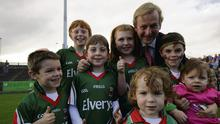 Taoiseach Enda Kenny with young fans Gavin, Odhran, Lexi, Noah, Cody, Hazel, and Eoin Murphy at the Mayo teams' homecoming at McHale Park in Castlebar