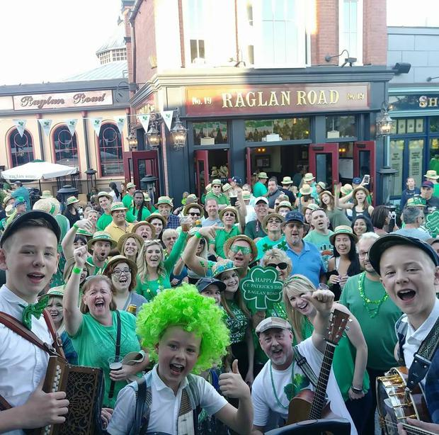 The Byrne brothers with a crowd outside Raglan Road