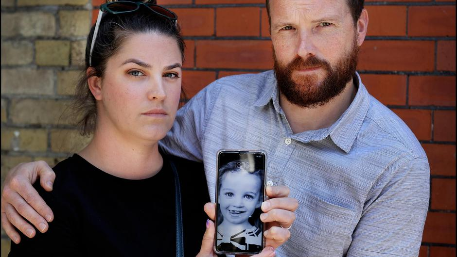 Estlin Wall's parents, Amy and Vincent, hold a photograph of their daughter outside the Coroner's Court in Dublin during the inquest into her tragic death. Photo: Steve Humphreys