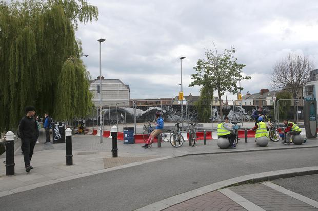 Dublin's Portobello Plaza has been cordoned off for the weekend after outbreaks recently of what the city council called 'completely unacceptable behaviour' by large crowds of up to 1,000 people gathering to socialise. Photo: Collins