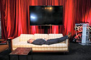 One attendee grabs forty winks on a couch at one of the pitching stages as the summit winds down. Photo: Maxwells