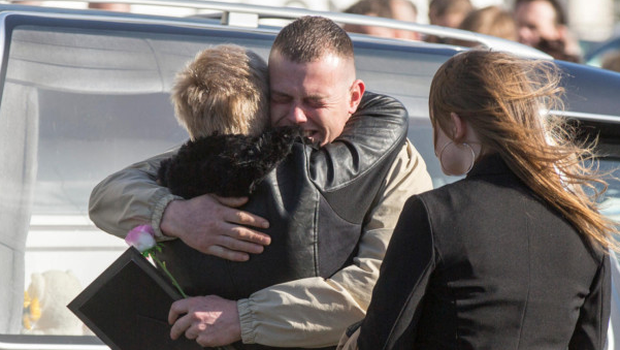 Jamie McGinn, father of Holly and Jordan, is consoled Picture: Mark Condren