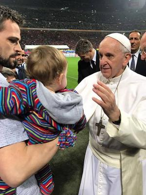 Leslie Martin with son Ciaran (1) receiving a special blessing from Pope Francis on Saturday