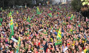 Thousands of fans turned out to welcome home the victorious Kerry senior football and minor teams in Tralee on Monday night.