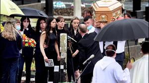 Mourners, family and friends attend the funeral mass of Killian Casey at St Mary's Church and adjoining cemetery at Crosserlough, Co Cavan. Photo: Steve Humphreys