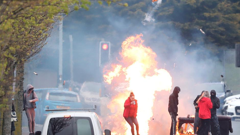 A fire burns in the middle of the Shankill Road in Belfast during further unrest this week. Photo: Niall Carson/PA