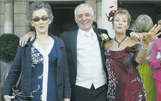 Broadcaster Eamon Dunphy, above, with his partner Jane Gogan, left, and former wife Sandra Tinsley at the wedding of his daughter, Colette in 2009