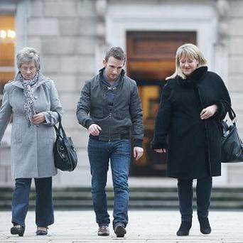 Campaigners (from left) Marina Gambold, Steven O'Riordan and Maureen Sullivan, of the group Magdalene Survivors Together, leave Leinster House
