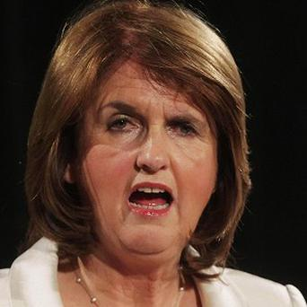 Joan Burton says money freed up from the promissory note deal should be used to slash tax hikes and spending cuts