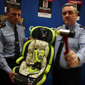 Detectives believe a hammer and a child's car seat could be clues into the murder of Garda Adrian Donohoe
