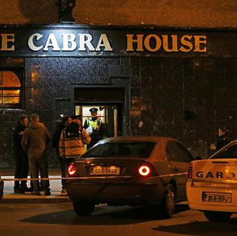 Gardai at the scene in Dublin where a man was shot dead in the Cabra House pub