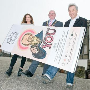 Kevin Campbell, centre, Frank Cottrell-Boyce and Grianne Devine are urging people to get involved in The Return of Colmcille (Culture Company/PA)