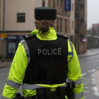 Three men have been arrested after a speeding car crashed with two PSNI vehicles in Belfast